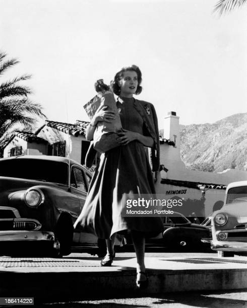 American actress and Princess consort of Monaco Grace Kelly walking carrying a paper bag in the film To Catch a Thief USA 1955