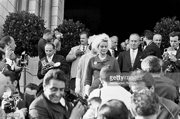American actress and princess of Monaco Grace Kelly going down the steps of the cathedral after Italian countess Fabrizia Citterio and Italian prince...