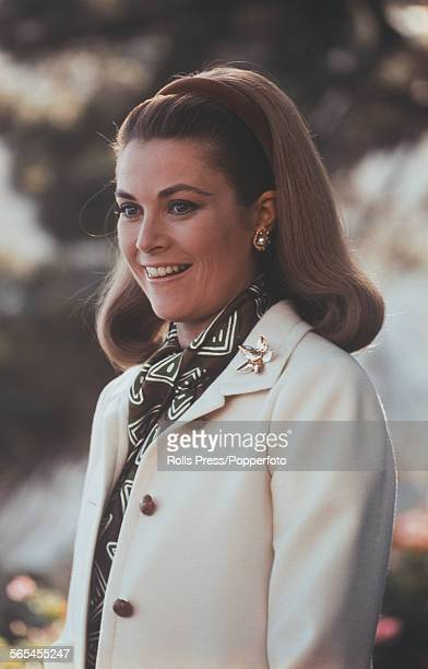 American actress and Princess of Monaco Grace Kelly pictured wearing a cream coloured coat and brown scarf and hair band circa 1968
