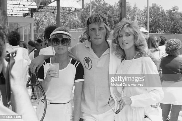 American actress and producer Donna Mills American actor Christopher Atkins and American actress Morgan Fairchild attend a tennis match circa 1980