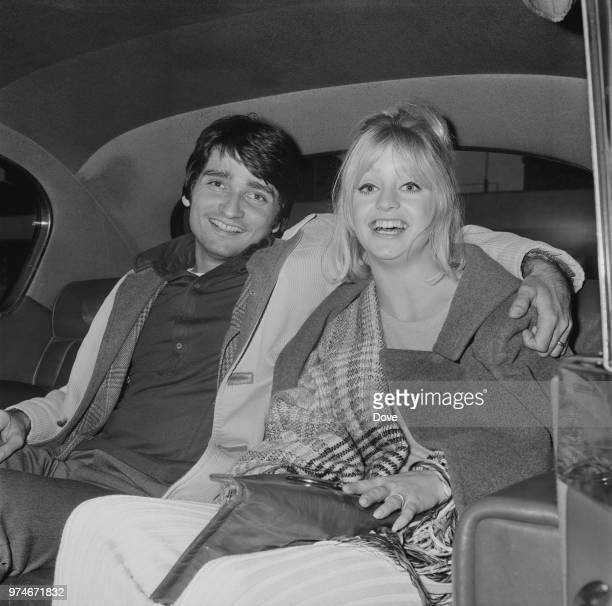 American actress and producer Goldie Hawn with his husband American actor dancer and director Gus Trikonis sitting in the backseat of a car at...
