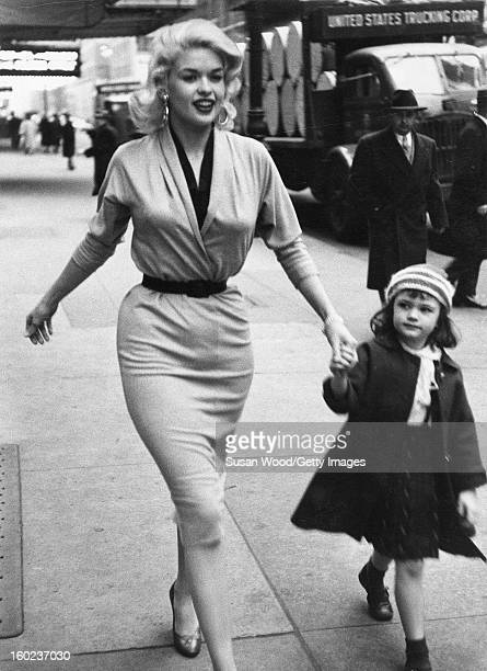 American actress and sex symbol Jayne Mansfield walks her daughter, future actress and model, Jayne Marie Mansfield, along a sidewalk in Midtown, New...