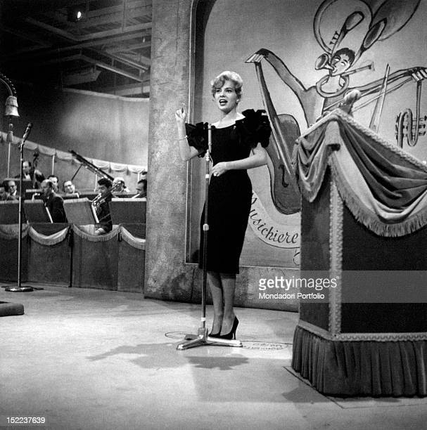 American actress and singer Abbe Lane performing in the TV show 'Il Musichiere' On the background some members of the orchestra Italy 1950s