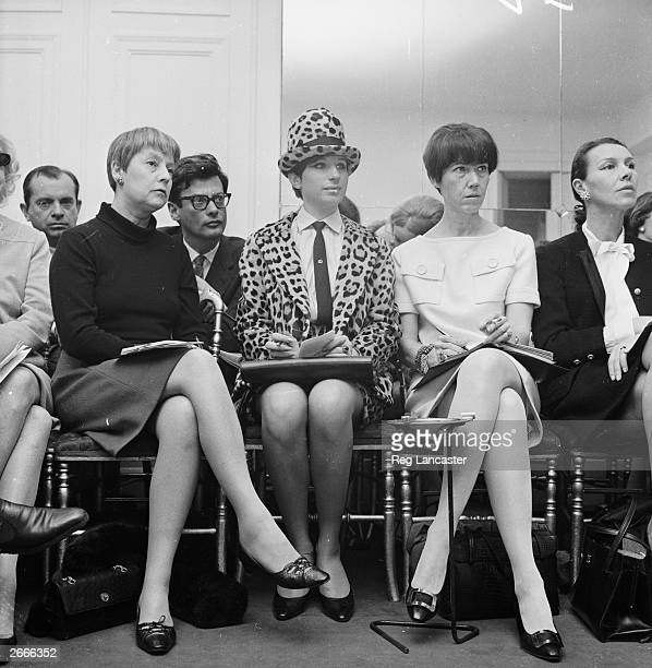 American actress and singer Barbra Streisand attends a Chanel fashion show in Paris wearing a leopard skin suit Photographer Richard Avedon is seated...