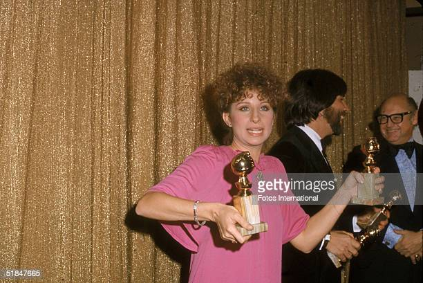 American actress and singer Barbra Streisand holds her two awards at the 34th Annual Golden Globe Awards held at the Beverly Hilton Hotel Beverly...
