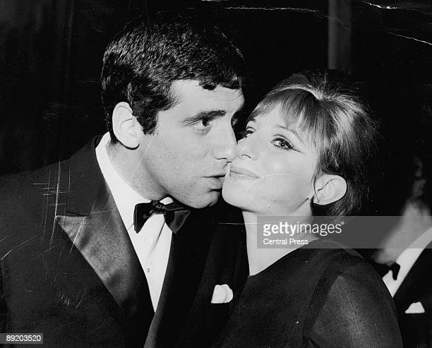 American actress and singer Barbra Streisand receives a kiss from her husband, actor Elliott Gould, on her opening night in 'Funny Girl' at the...