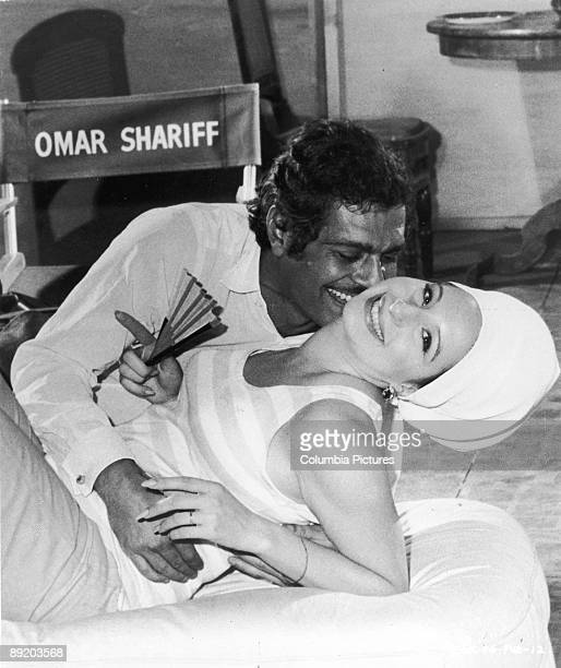 American actress and singer Barbra Streisand with actor Omar Sharif circa 1980 They are recreating their love scene from the 1968 film 'Funny Girl'