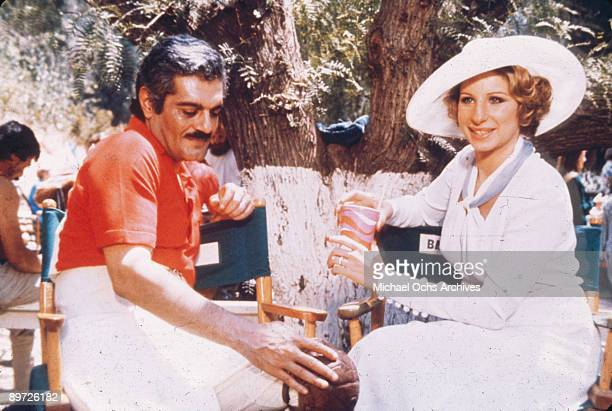 American actress and singer Barbra Streisand with costar Omar Sharif on the set of the movie 'Funny Lady' 1975