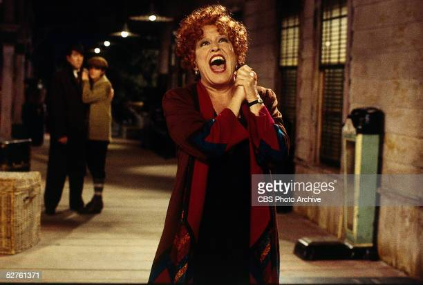 American actress and singer Bette Midler performs in an alleyway during a scene from the television movie 'Gypsy' directed by Emile Ardolino 1993