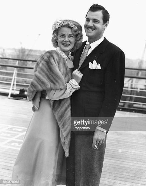 American actress and singer Betty Hutton and her husband Ted Briskin pictured together on the deck of the Queen Mary as the liner prepares to dock at...