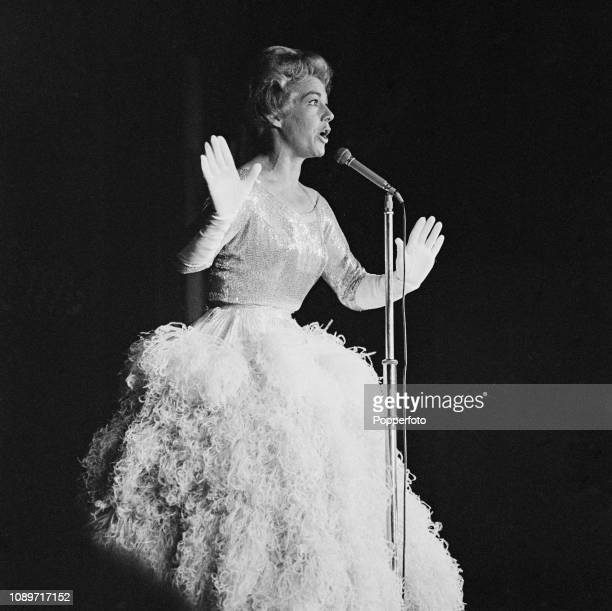 American actress and singer Betty Hutton performs live on stage at the Pigalle Club in London in March 1961