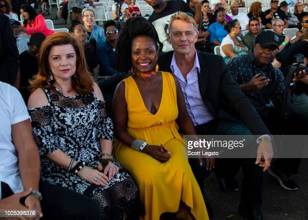 American actress and singer Crystal R Fox and John Schneider attends the Aretha Franklin tribute concert at Chene Park on August 30 2018 in Detroit...