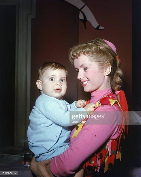 American actress and singer Debbie Reynolds holding her infant son Todd Fisher 1959