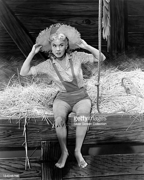 American actress and singer Doris Day in a straw hat and dungarees as Marjorie Winfield in the musical 'By the Light of the Silvery Moon' directed by...