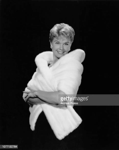 American actress and singer Doris Day wearing a white mink stole designed for her by Harry Rosoff for the Paramount Pictures film 'The Man Who Knew...