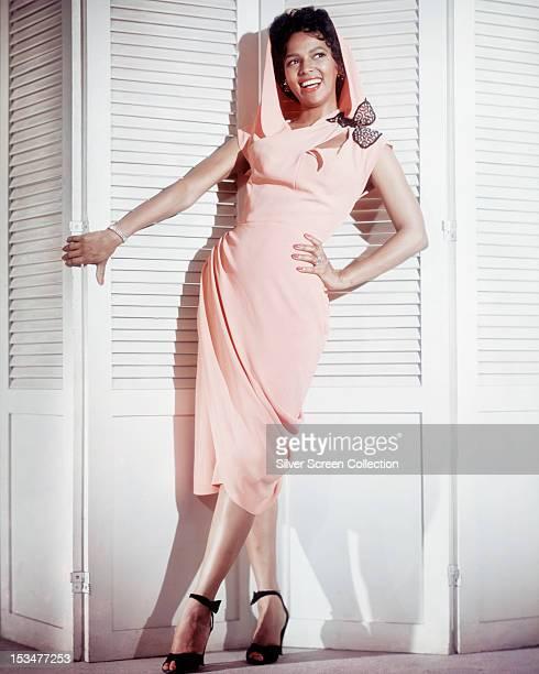 American actress and singer Dorothy Dandridge wearing a hooded dress circa 1955