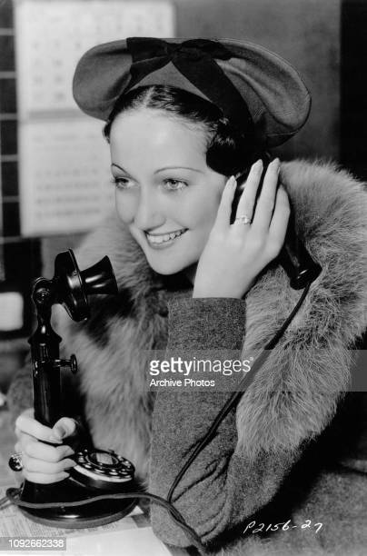 American actress and singer Dorothy Lamour phones her husband orchestra leader Herbie Kay from the set of the film 'The Jungle Princess' circa 1936