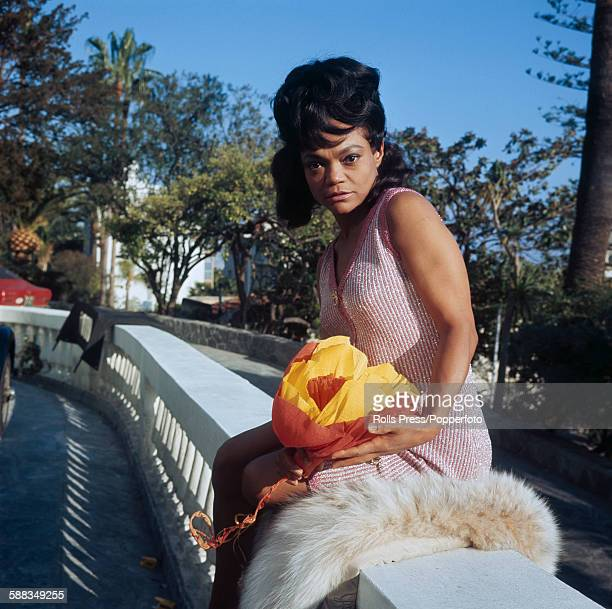 American actress and singer Eartha Kitt pictured sitting on a balcony outside the casino at the Sanremo Music Festival in Sanremo Italy in January...