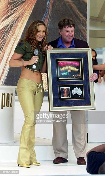 American actress and singer Jennifer Lopez is presented with a plaque after her live performance at Darling Harbour on February 22 2001 in Sydney...