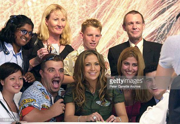 American actress and singer Jennifer Lopez poses for a photograph with fans after her live performance at Darling Harbour on February 22 2001 in...