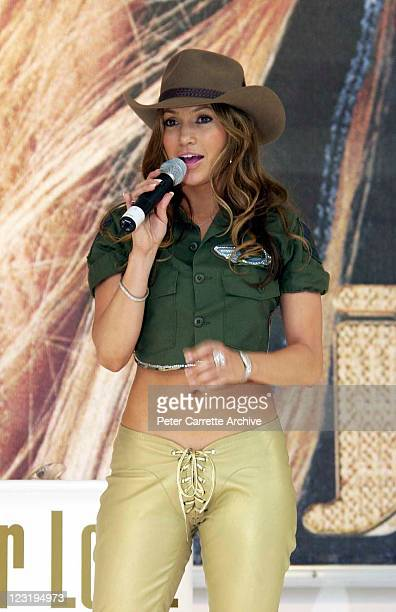American actress and singer Jennifer Lopez tries on a traditional Australian Akubra hat after her live performance at Darling Harbour on February 22...