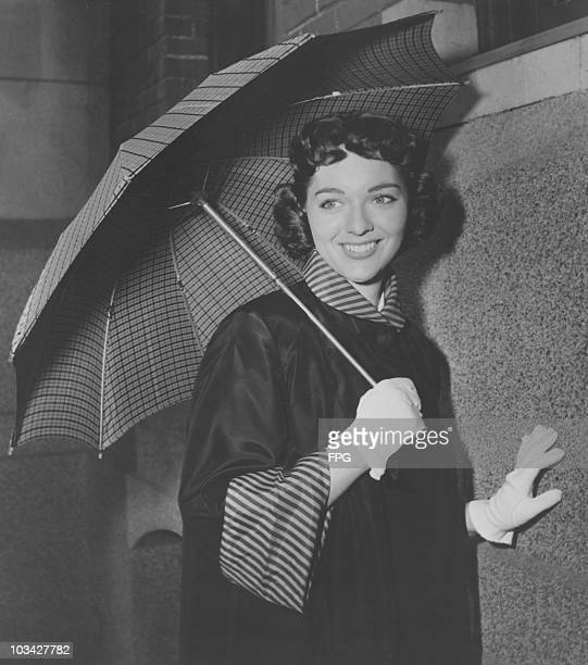 American actress and singer Joan Weldon in the rain circa 1955