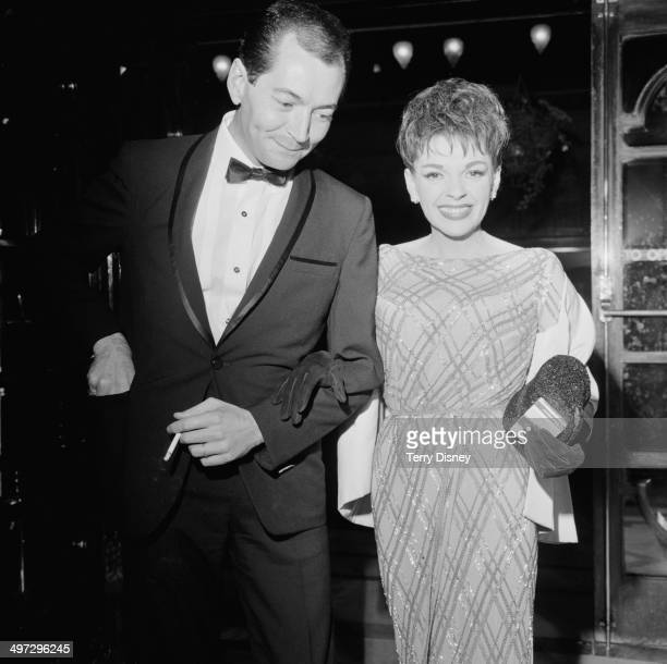 American actress and singer Judy Garland and her partner Mark Herron attend the 'Night of 100 Stars' at the London Palladium, 23rd July 1964.