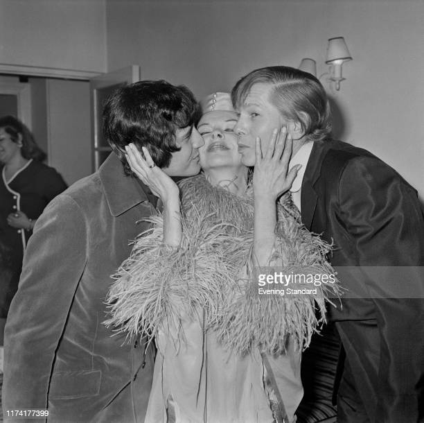 American actress and singer Judy Garland is kissed by her new 5th husband Mickey Deans and best man Johnnie Ray on the day of their wedding at...