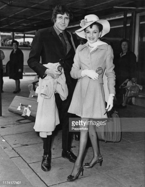 American actress and singer Judy Garland posed with her 5th husband Mickey Deans at Heathrow Airport in London on 21st May 1969