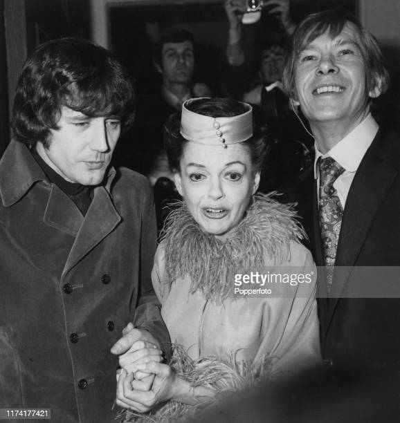 American actress and singer Judy Garland posed with her new 5th husband Mickey Deans and best man Johnnie Ray on the day of their wedding at Chelsea...