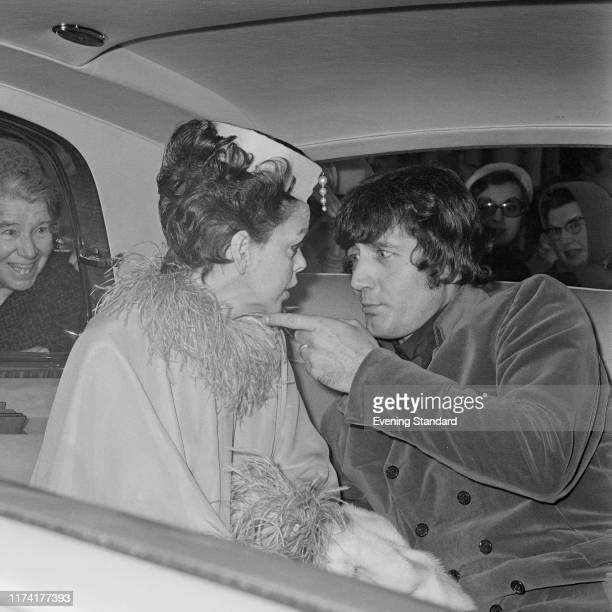 American actress and singer Judy Garland seated with her new 5th husband Mickey Deans in their limousine car as they leave Chelsea Register Office in...