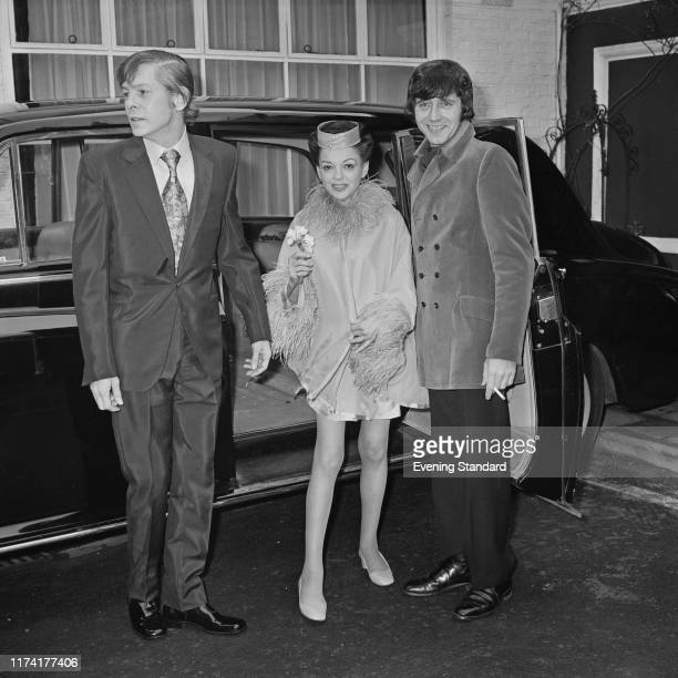 American actress and singer Judy Garland stands with her 5th husband to be Mickey Deans and best man Johnnie Ray beside their limousine car on the...