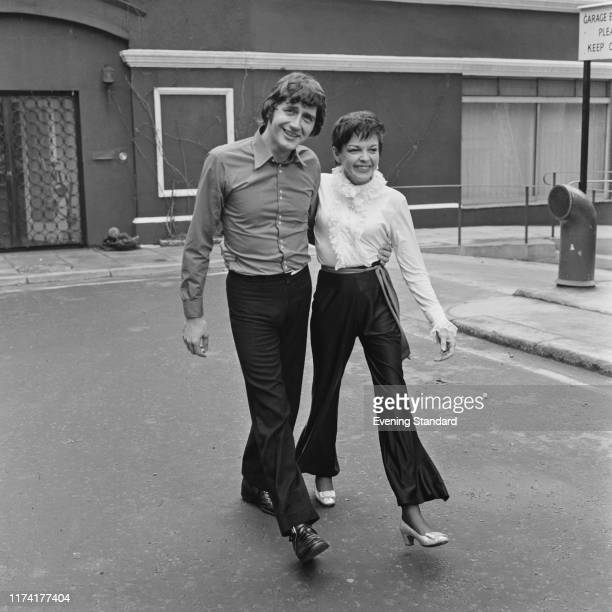 American actress and singer Judy Garland walks with her 5th husband to be Mickey Deans on the day of their wedding at Chelsea Register Office in...