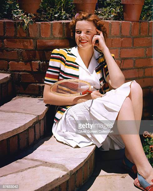 American actress and singer Judy Garland with a badminton racket circa 1945