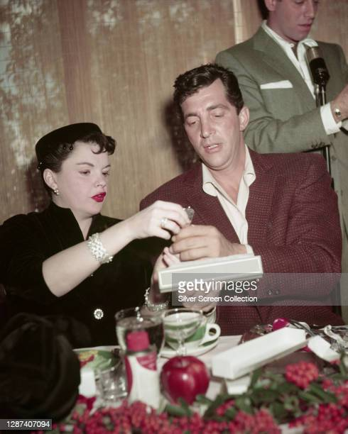American actress and singer Judy Garland with actors Dean Martin and Jerry Lewis at the Women's Press Club's Golden Apple awards, USA, 28th December...