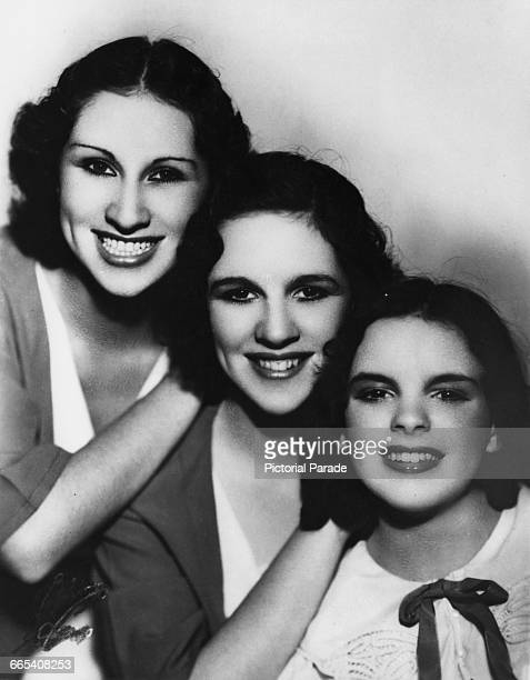 American actress and singer Judy Garland with her sisters in a promotional portrait for their musical trio The Gumm Sisters circa 1935 From left to...