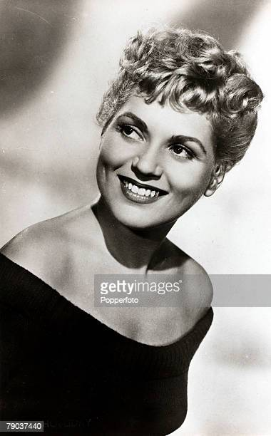 Cinema Personalities circa 1940's American actress Judy Holliday who filled the role of the dumb blonde in many films who in fact was the reverse in...