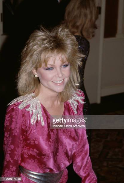 American actress and singer Lisa Hartman, wearing a pink outfit with silver sequin decoration on the shoulders, attends the 40th Annual Golden Globe...