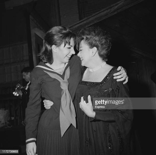 American actress and singer Liza Minnelli with her mother, American actress and singer Judy Garland , backstage after she opened in 'Flora the Red...