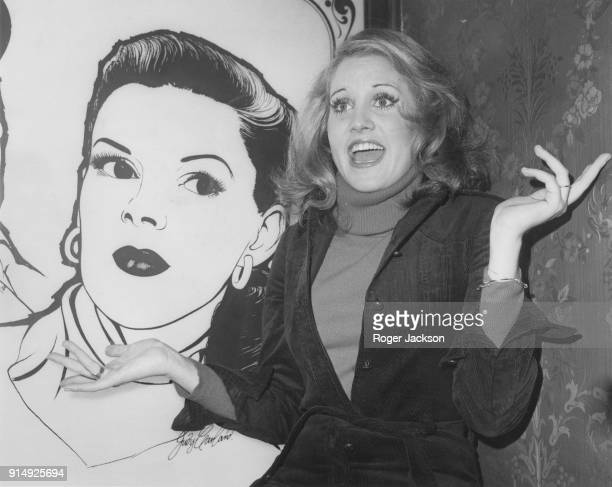 American actress and singer Lorna Luft daughter of Judy Garland poses by an autographed painting of her mother during a press reception in the bar of...