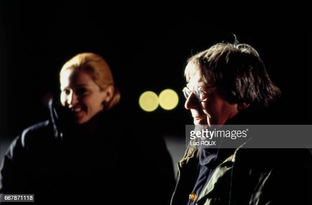 American actress and singer Madonna with British director screenwriter and producer Alan Parker on the set of his musical film Evita based on the...