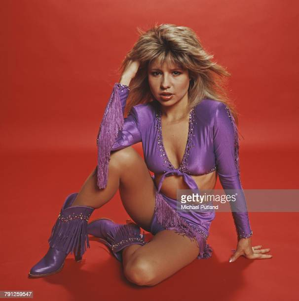 American actress and singer Pia Zadora posed wearing a purple top and shorts with matching boots in 1982