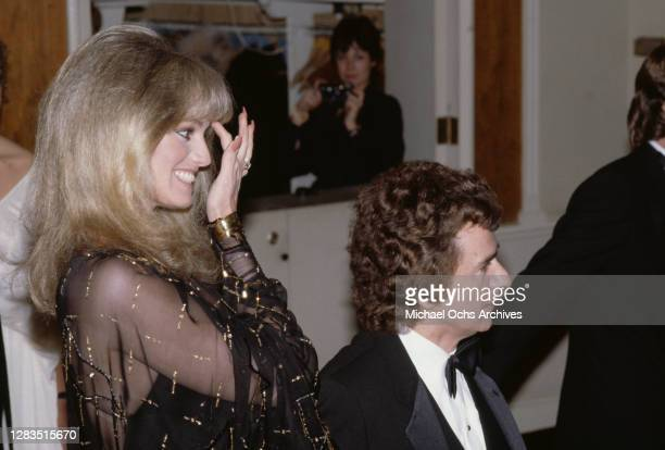 American actress and singer Susan Anton and British actor, comedian and pianist Dudley Moore attend the 40th Annual Golden Globe Awards, held at the...