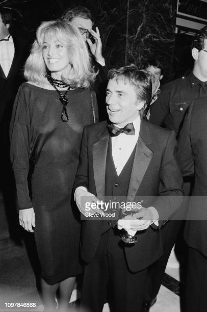 American actress and singer Susan Anton and English actor comedian and musician Dudley Moore attend gala dinner to honour Prince Andrew by the...