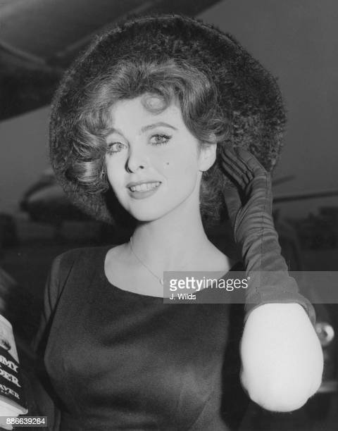 American actress and singer Tina Louise arrives at London Airport from Rome to attend the British premiere of her latest film 'God's Little Acre' 2nd...