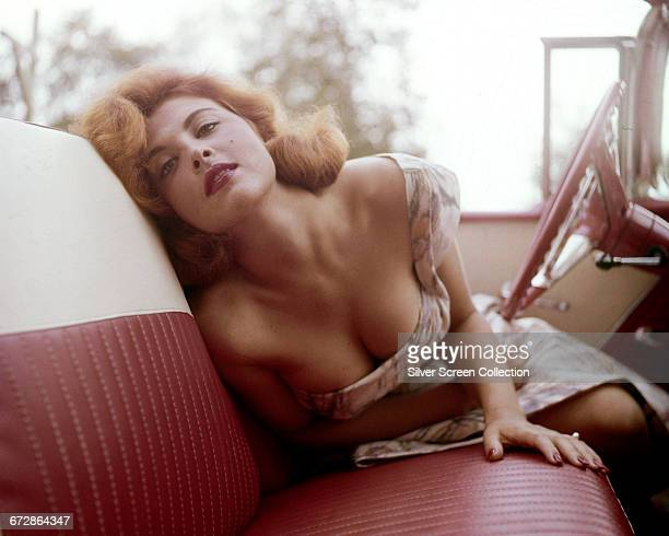 American actress and singer Tina Louise at the wheel of a convertible circa 1965