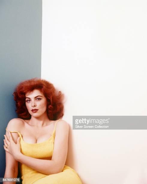 American actress and singer Tina Louise wearing a yellow dress circa 1955