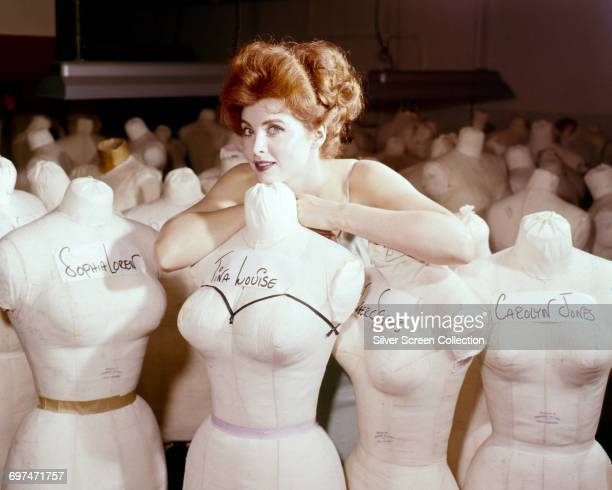 American actress and singer Tina Louise with a collection of mannequin busts including ones of herself Sophia Loren Inger Stevens and Carolyn Jones...