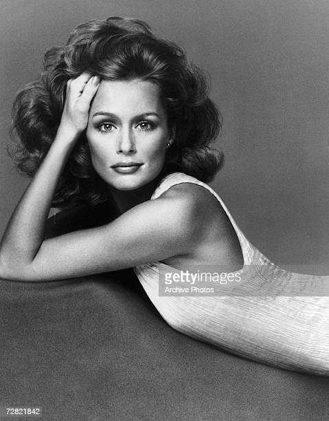 American actress and supermodel Lauren Hutton poses in a sleeveless dress in a pleated fabric possibly by Mary McFadden 1974