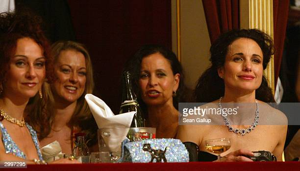 American actress Andie MacDowell Christina Lugner and two unidentified women attend the Vienna Opera Ball at the city's opera house February 19 2004...